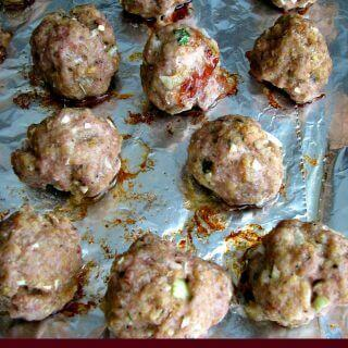 Perfect Meatballs, made with a mixture of ground beef, pork, veal, onions, garlic, and Italian seasonings. They are great on their own, for spaghetti and meatballs, or in a meatball sub.