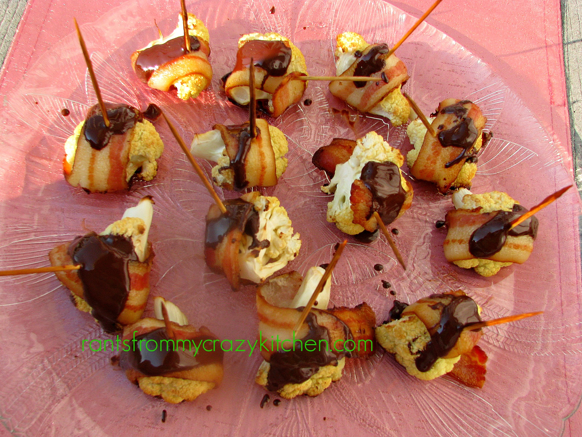 photo of Bacon Wrapped Cauliflower with Dark Chocolate on a glass platter