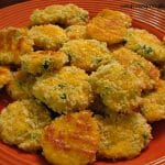 Photo of a full plate of Jalapeno Cheddar Bites on a dark orange plate