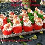 Photo of Bacon Cream Cheese Stuffed Cherry Tomatoes in a glass plate on a rod iron table