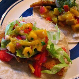 Spicy Fish Tacos- Quick, spicy fish tacos with a fabulous mango salsa great for weeknight dinners.