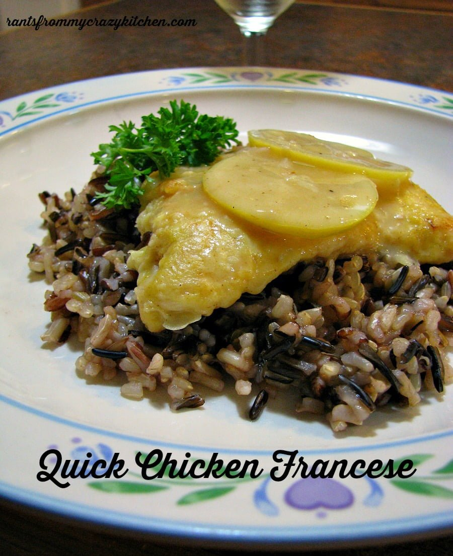 photo of a plate of chicken francese over a bed of wild rice