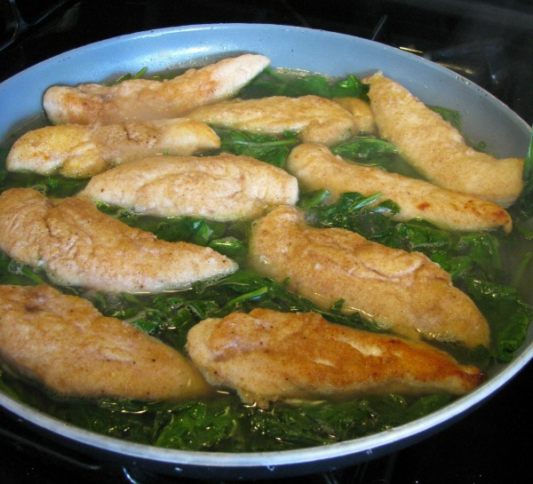 Chicken and Spinach in a skillet for Skillet Chicken with Spinach and Avocado recipe.