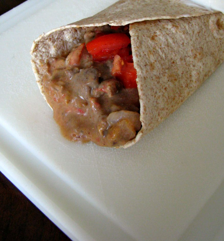 Simmered ground beef in a cheesy sauce, topped with diced fresh tomatoes and wrapped in a flour tortilla. Mexican fast food at home!