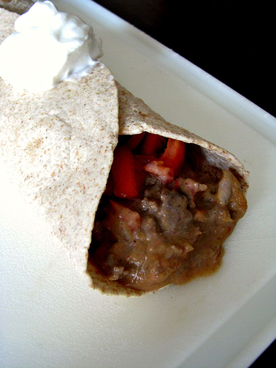 Cheesy ground beef in a Mexican inspired sauce wrapped in a soft flour tortilla, this Beef Meximelt is easy to make at home, and healthier than fast food!