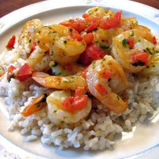 Quick and easy Shrimp and Bell Pepper Skillet with scallions, parsley, and black pepper in a butter sauce served over brown rice.