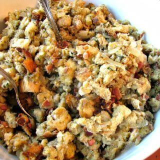 Slow Cooker stuffing loaded with bacon, sauteed onions, and sage. Save room in your oven by making your stuffing easily in your slow cooker.