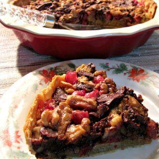This festive Chocolate Walnut Cranberry Pie is both sweet and tart, and a great change from a typical pecan pie, making it a great addition to any holiday dessert table.