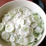 Photo of Creamy Cucumber Salad in a white bowl