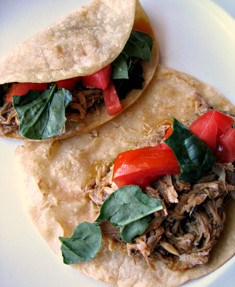 These Slow Cooker Pork Carnitas are bursting with flavor! Pork shoulder simmered with the perfect blend of seasonings, onions, and garlic simmered in orange juice and lime juice, then quickly fried. You won't want to wait for Taco Tuesday for these!