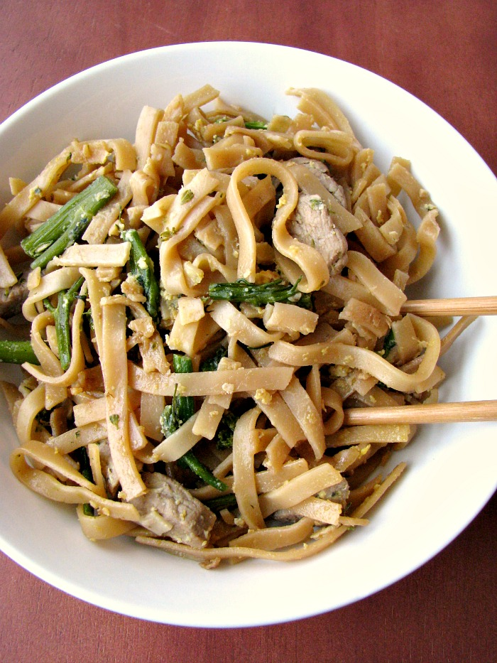 """Pad See Ew ( meaning """"fried with soy sauce"""") is made with large rice noodles, pork loin, broccoli, and scrambled eggs fried in soy sauce. Makes a great weeknight dinner and better than takeout!"""