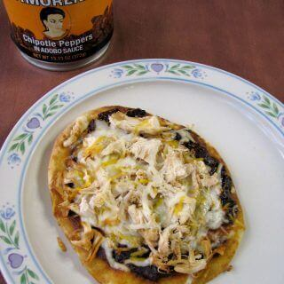 Chicken Naan Pizza is easy to make, with diced cooked chicken, chipotle peppers in adobo, Mexican and mozzarella cheeses on top of naan flatbreads.