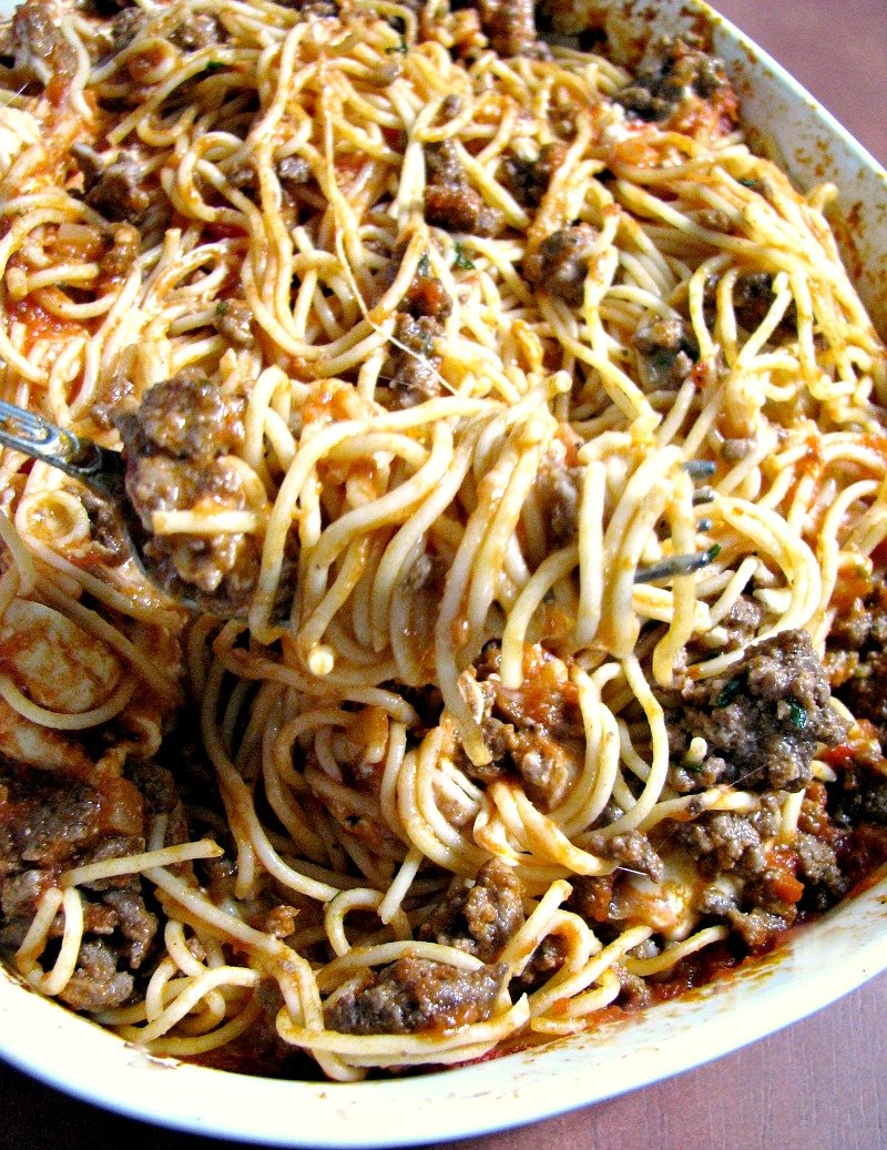 This Leftover Spaghetti Casserole comes together quickly and easily, with ground beef or turkey, Mozzarella and American cheeses, and store-bought sauce.