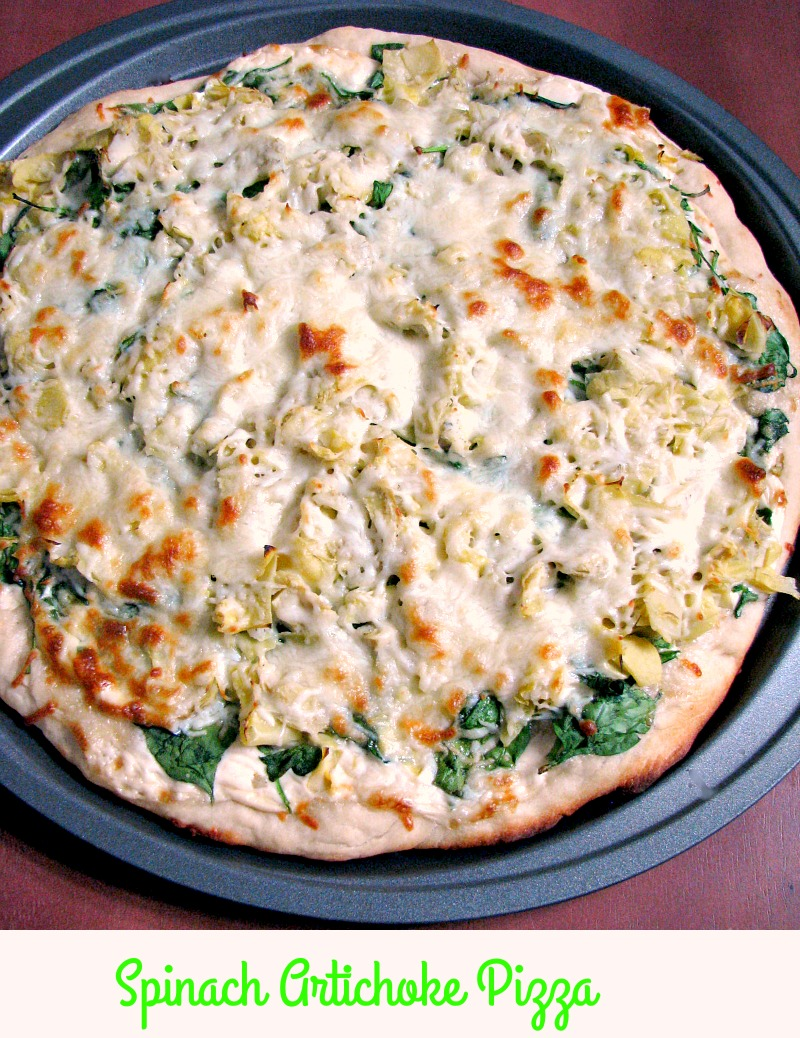 Quick and easy Spinach Artichoke Pizza, made with store-bought pizza dough, canned artichoke hearts, fresh spinach, and Alfredo sauce makes a great meatless meal.