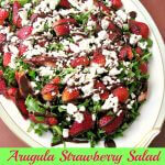 With crisp arugula, sweet strawberries, crumbled goat cheese, and a homemade chocolate balsamic vinaigrette, Arugula Strawberry Salad with Chocolate Vinaigrette is perfect for Easter dinner.