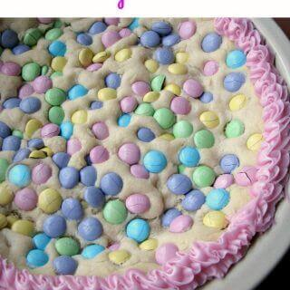 This Easter Sugar Cookie Pie, made with refrigerated cookie dough and pastel colored chocolate candy, is a great, easy, sweet treat.