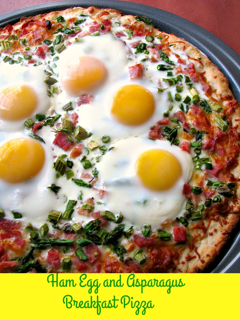 Cheesy Ham Egg and Asparagus Breakfast Pizza made with a homemade pizza crust is perfect for brunch!