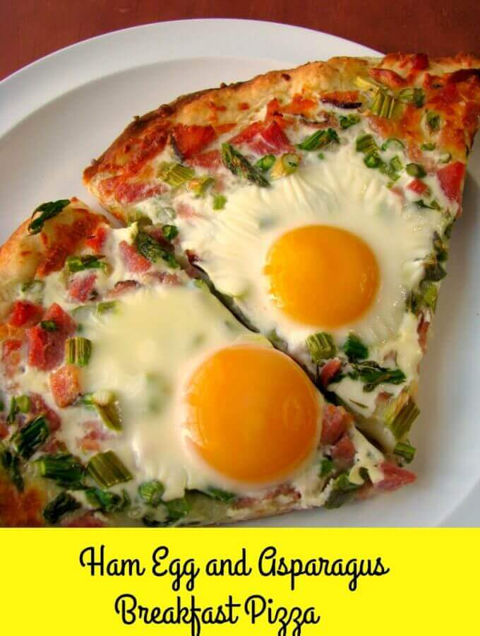 Cheesy Ham Egg and Asparagus Breakfast Pizza made with a homemade pizza crust, diced ham, asparagus, and sunny-side up eggs, is perfect for brunch!