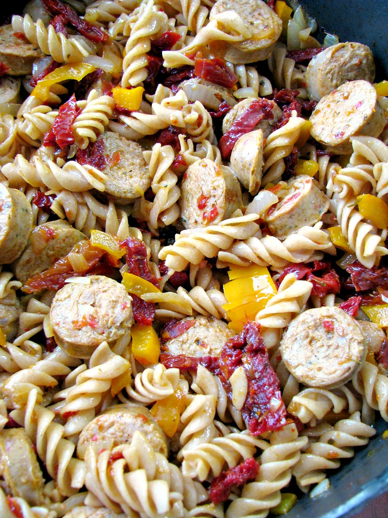 Quick and easy One Pot Chicken Sausage Pasta made with precooked chicken sausage, bell peppers, onions, and sun dried tomatoes makes a great weeknight summertime dinner.