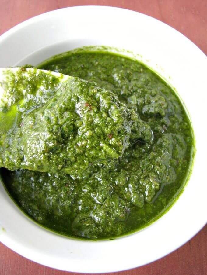 Homemade Bacon Pesto, with fresh basil and crispy bacon, makes a great topping for chicken or pasta, spread for pizza, or use it as a dip for crusty bread.
