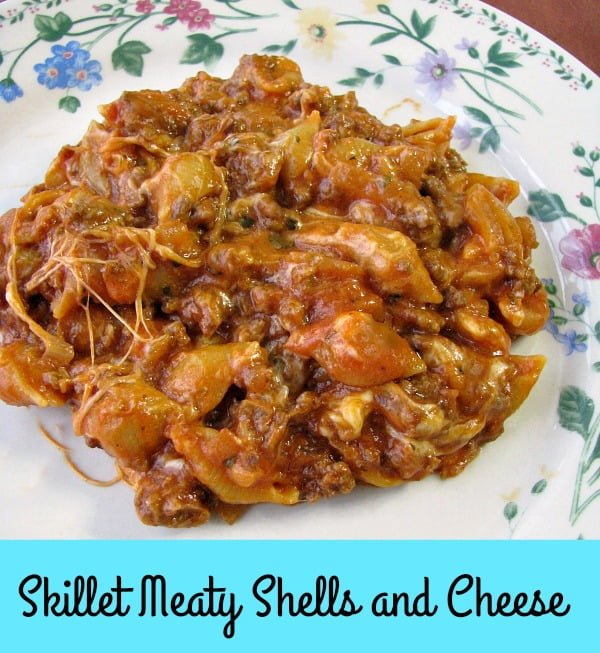 With mini pasta shells, ground beef, tomato sauce, and lots of gooey mozzarella cheese, this Skillet Meaty Shells and Cheese dinner is perfect for weeknights.