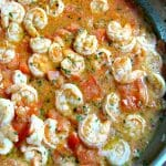 A delicious change from traditional shrimp scampi, Red Shrimp Scampi is made with lots of garlic, tomatoes, parsley, and black pepper in butter sauce.