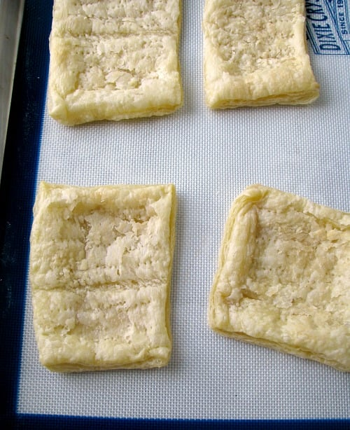 Photo of pre-baked puff pastry deflated on a baking sheet