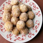 Photo of a plate of Chinese Sugar Donuts on a white and red plate