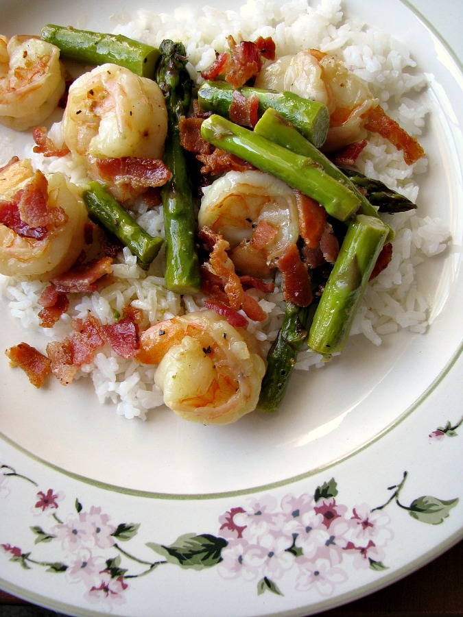 Photo of Shrimp Asparagus Bacon Skillet meal on a white plate with flower trim