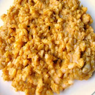Close up photo of Creamy Pumpkin Risotto on a white plate