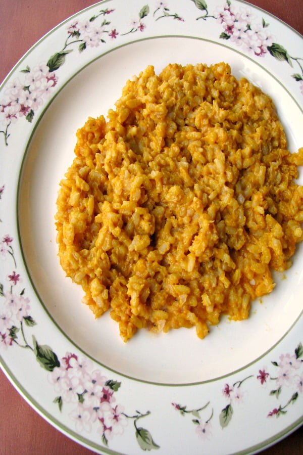 Photo of plated Creamy Pumpkin Risotto on a white plate with flowered trim