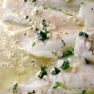 Photo of Baked Flounder with Lemon Garlic Butter in a glass baking dish