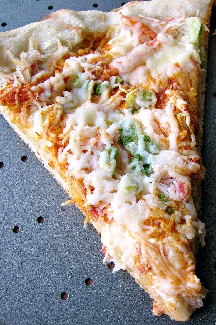 Close up photo of Homemade Crab Rangoon Pizza on a metal pizza pan