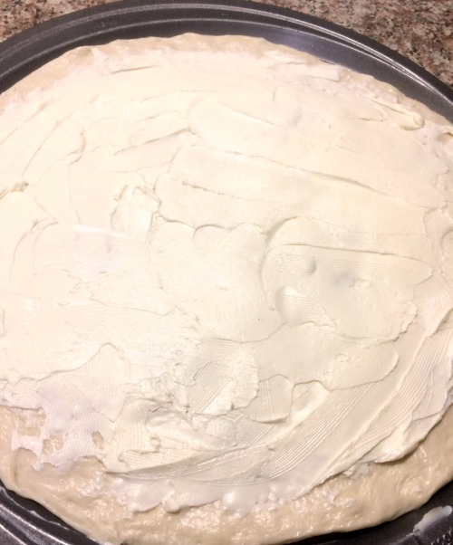 photo of cream cheese topped pizza dough