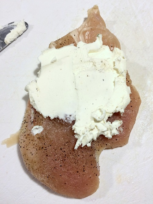 Photo of cream cheese on a chicken breast