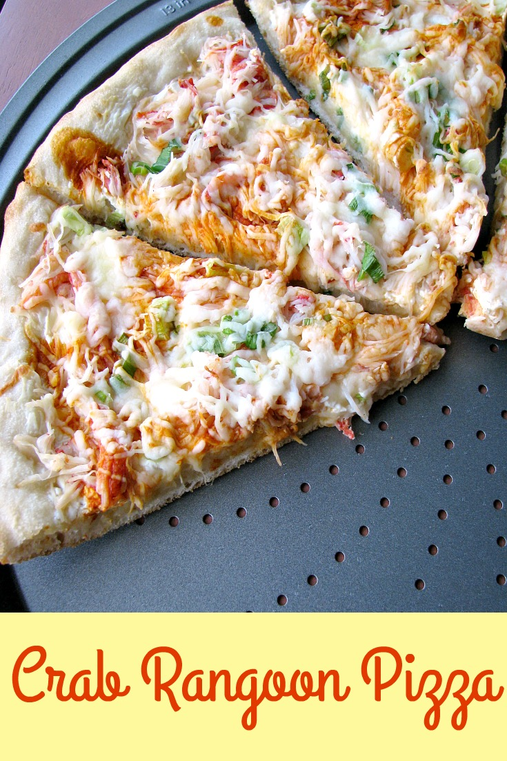 Photo of baked Homemade Crab Rangoon Pizza on a round pizza pan with the lower slices removed