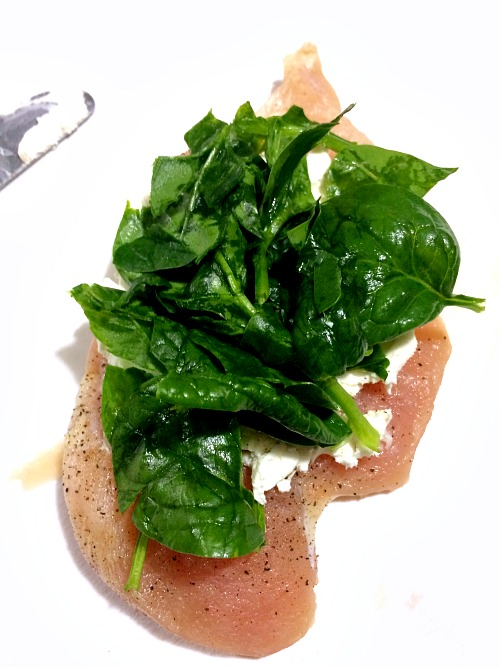 Photo of spinach and cream cheese topped chicken breast