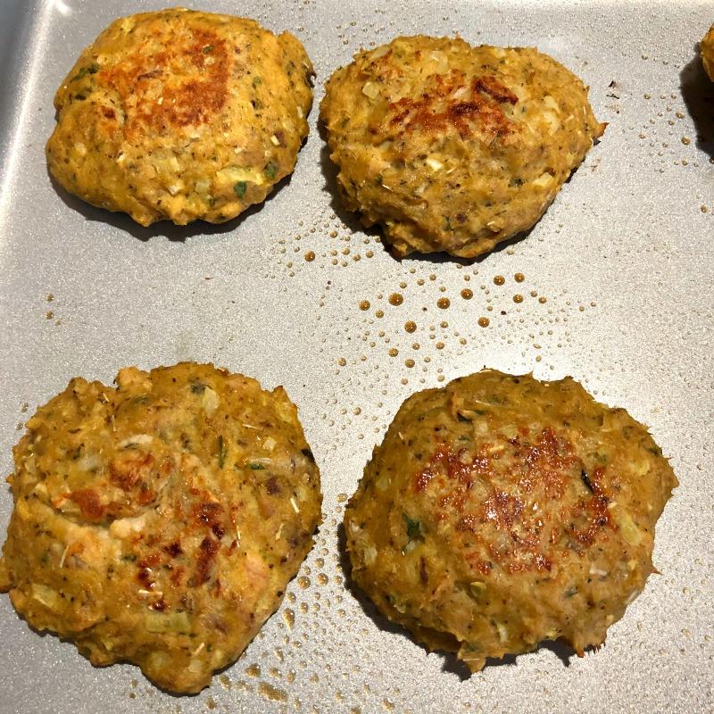 photo of baked salmon patties on a baking sheet
