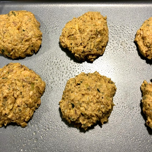 photo of unbaked salmon patties on a baking sheet