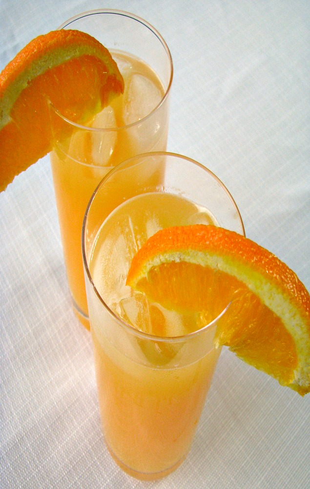 Overhead photo of two glasses of Peach Mimosa