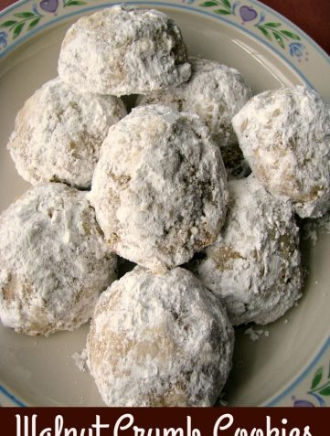 Photo of a white flower trimmed plate full of Walnut Crumb Cookies
