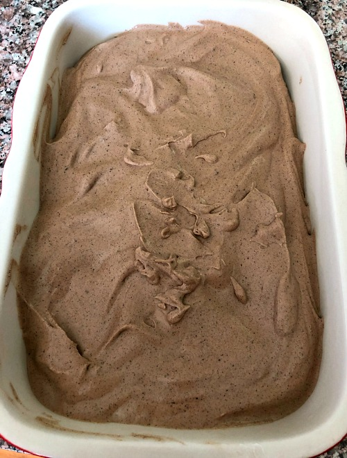 photo of unfrozen ice cream mixture in a ceramic loaf pan