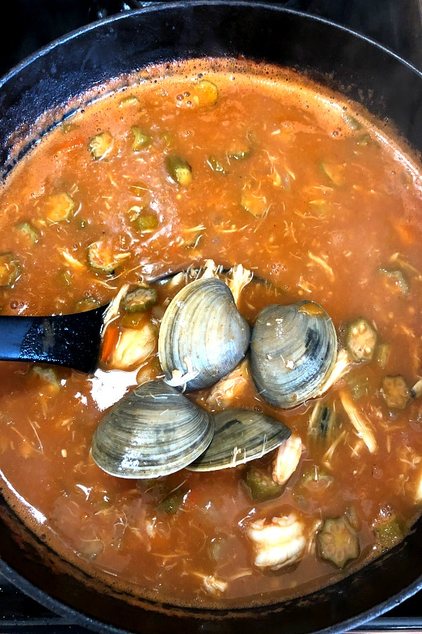 photo of seafood gumbo with clams added to the pot