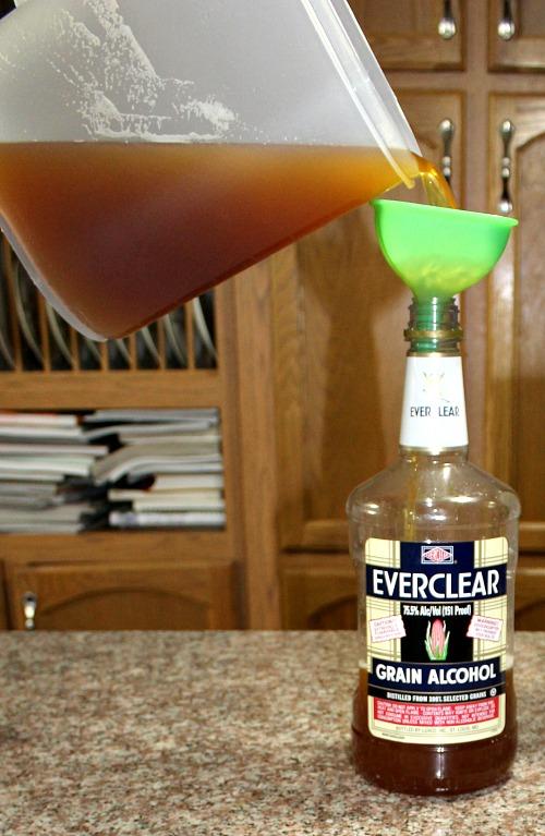 photo of Krupnik mixture being funneled into a bottle