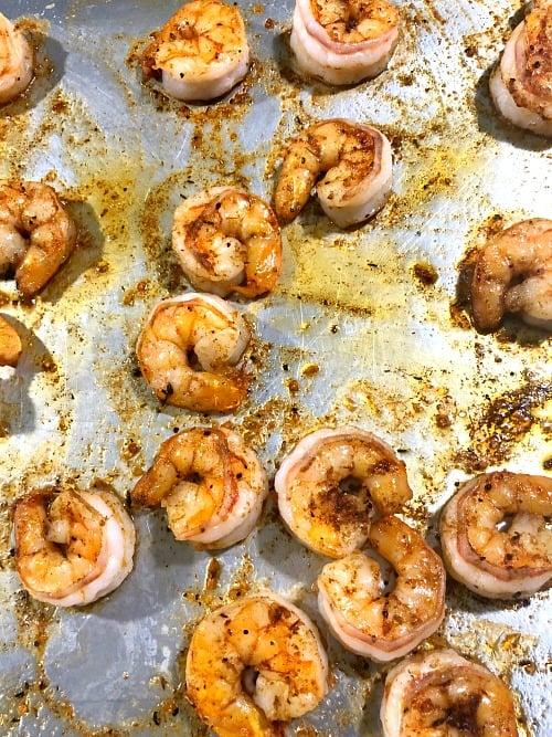 photo of cooked cajun shrimp on a baking sheet