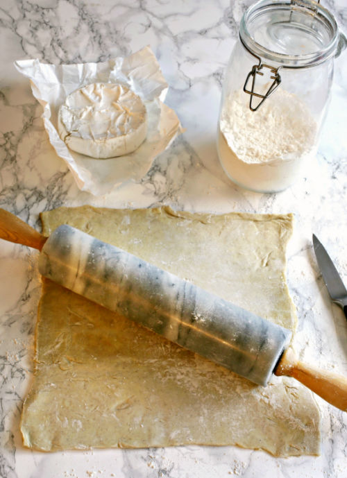 photo of puff pastry dough being rolled out with a rolling pin