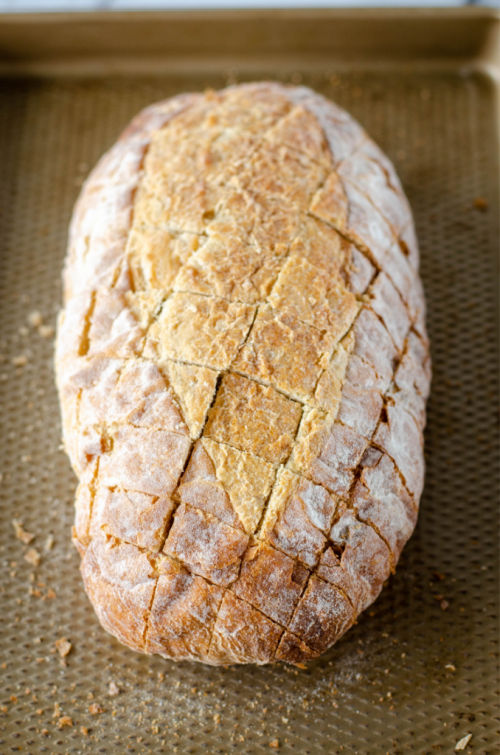 photos of a loaf of crusty bread with diagonal cuts on top