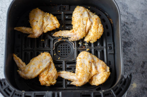 uncooked wings in an air fryer
