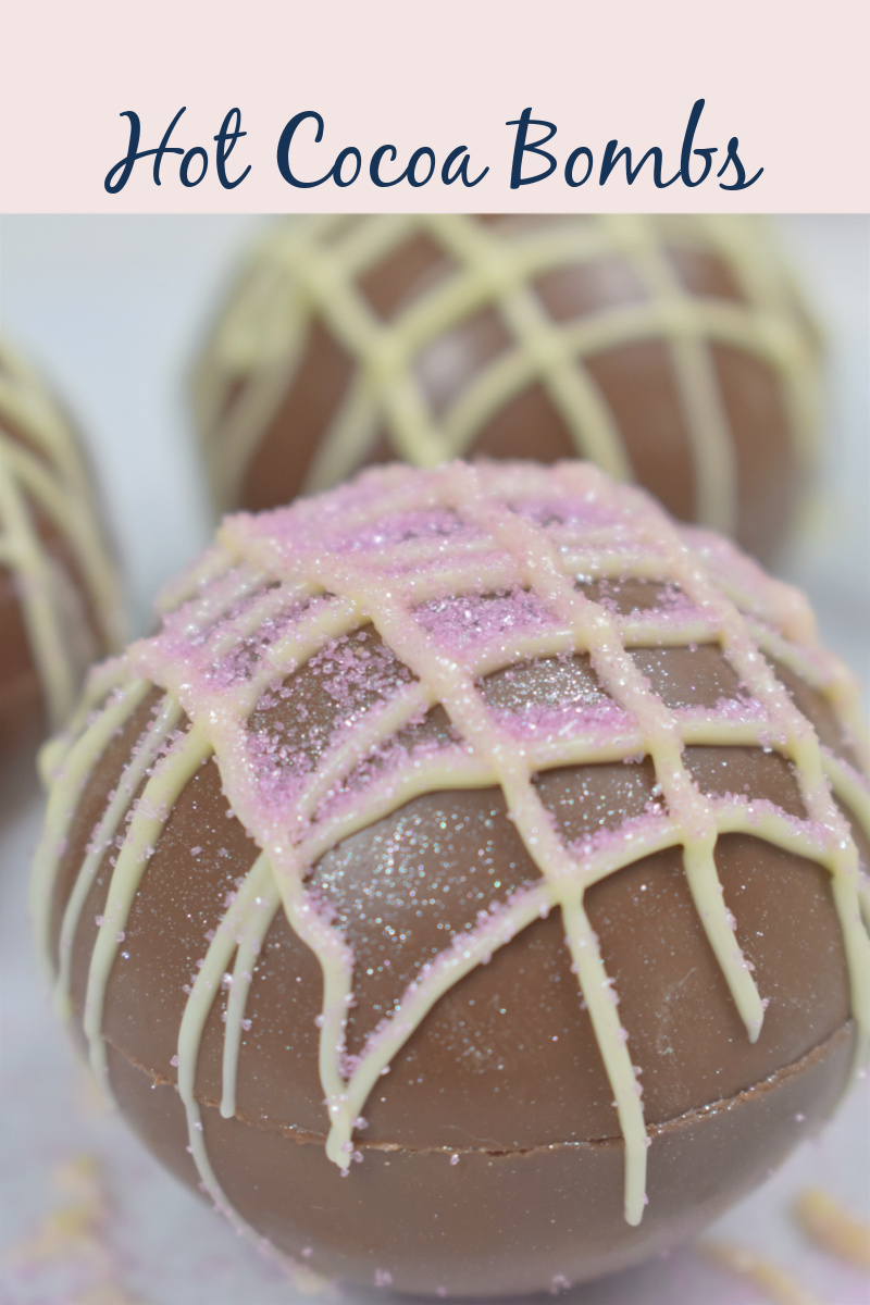 photo of hot chocolate bombs decorated with glitter and melted colored chocolate