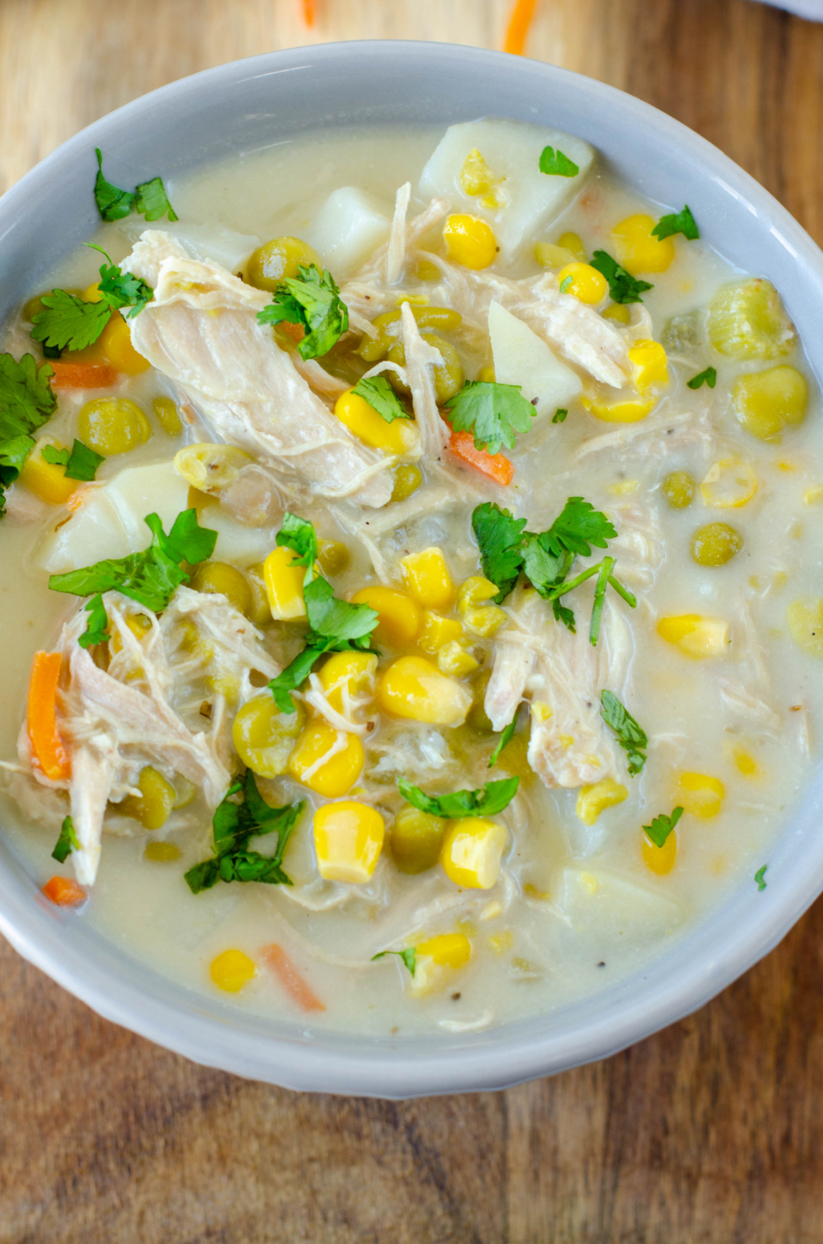a white bowl full of chicken pot pie soup
